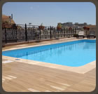 A large open air swimming pool and spacious sun deck